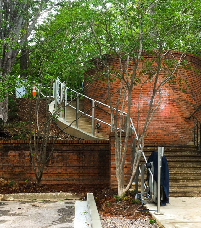 Outdoor Artira installed on stairs, brick building