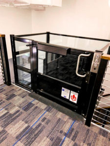 Genesis Enclosure installation in powder coated black from the upper floor