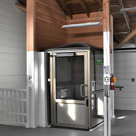 Genesis Enclosure installed at wooden building