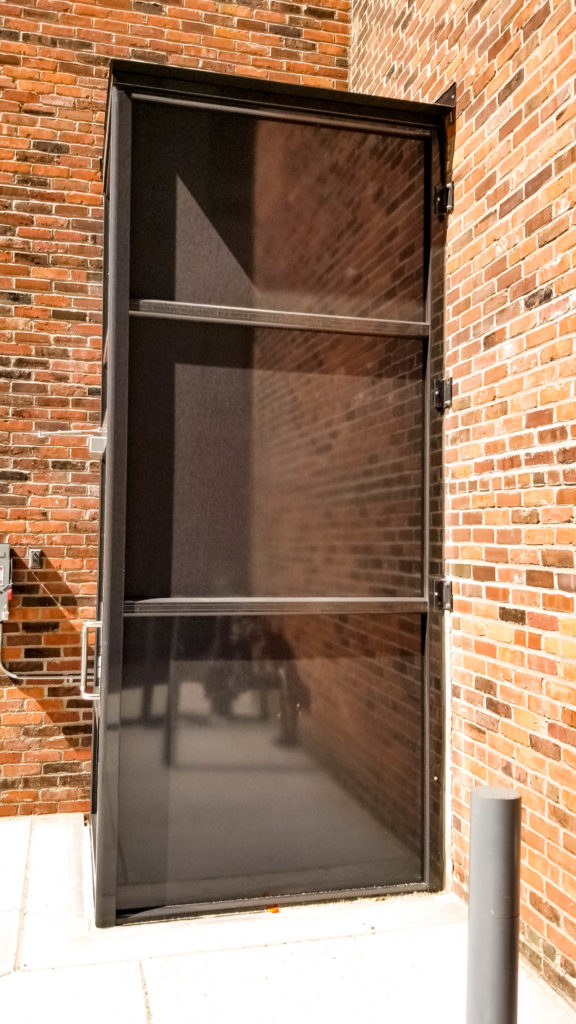 Outdoor Genesis Enclosure installed at brick wall