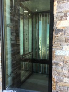 Elvoron Home Elevator in brick building