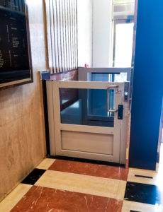 Genesis Shaftway installed lift within an existing Marble structure and brass finish