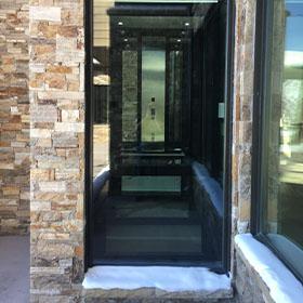 Home Elevator installed in brick building