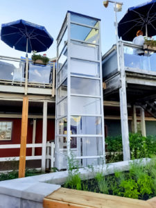 Genesis Enclosure outdoor installation with glass walls